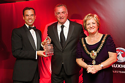 CARDIFF, WALES - Monday, October 6, 2014: Former Wales and Everton captain Kevin Ratcliffe is presented with the FAW Service Award by Prince's Gate's Ken Skates AM and Lord Mayor of Cardiff Margaret Jones at the FAW Footballer of the Year Awards 2014 held at the St. David's Hotel. (Pic by David Rawcliffe/Propaganda)