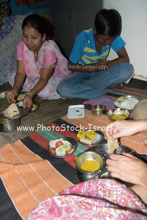 India, Rajasthan, Jaipur woman preparing food in her home
