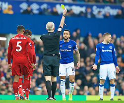 LIVERPOOL, ENGLAND - Sunday, March 3, 2019: Everton's Theo Walcott is shown a yellow card by referee Martin Atkinson during the FA Premier League match between Everton FC and Liverpool FC, the 233rd Merseyside Derby, at Goodison Park. (Pic by Paul Greenwood/Propaganda)