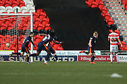 Blackpool forward Mark Cullen (9) scores a goal and celebrates to make the score 0-1 during the Sky Bet League 1 match between Doncaster Rovers and Blackpool at the Keepmoat Stadium, Doncaster, England on 28 March 2016. Photo by Simon Davies.