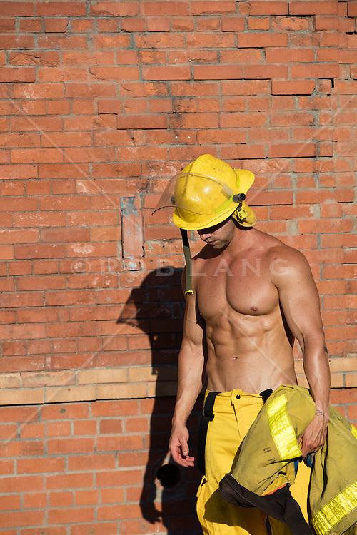 sexy muscular fireman without a shirt outdoors