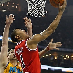 February 12, 2011; New Orleans, LA, USA; Chicago Bulls point guard Derrick Rose (1) shoots over New Orleans Hornets center Aaron Gray (34) during the first quarter at the New Orleans Arena.   Mandatory Credit: Derick E. Hingle