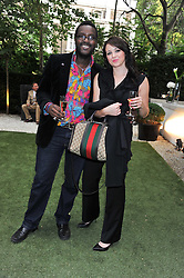 ORLANDO HAMILTON and LAURA DEWHURST at a garden party hosted by Piaget at The Hempel Hotel, London on 14th July 2011.