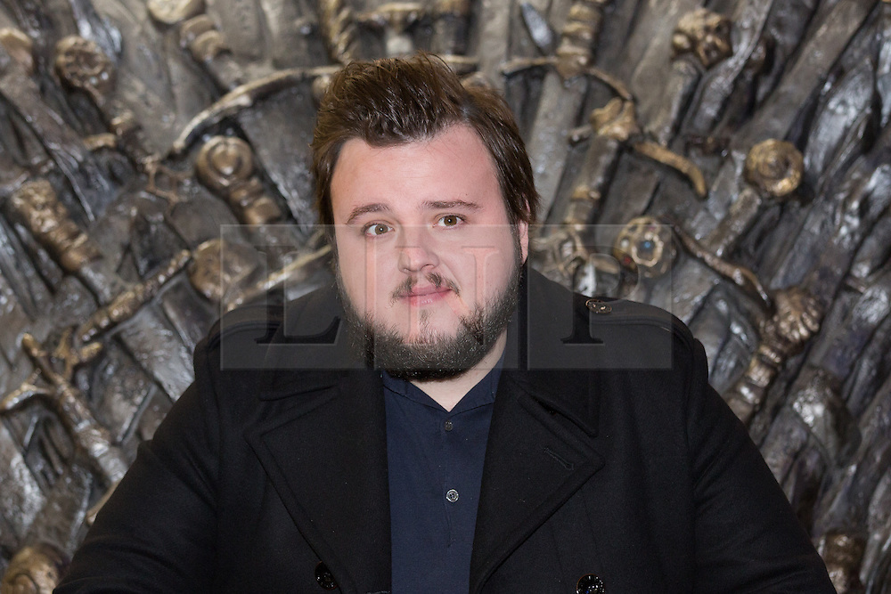 © Licensed to London News Pictures. 09/02/2015. London, UK. Actor, John Bradley sits on the throne at the Game of Thrones Exhibition on 9th February 2014 at the O2 Arena in Greenwich, south-east London. Photo credit : Vickie Flores/LNP