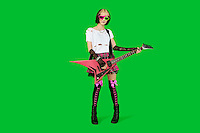 Punk woman with guitar over green colored background
