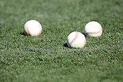 ANAHEIM, CA - JULY 28:  Baseballs lie on the infield grass during batting practice before the Los Angeles Angels of Anaheim game against the Tampa Bay Rays on Saturday, July 28, 2012 at Angel Stadium in Anaheim, California. The Rays won the game in a 3-0 shutout. (Photo by Paul Spinelli/MLB Photos via Getty Images)