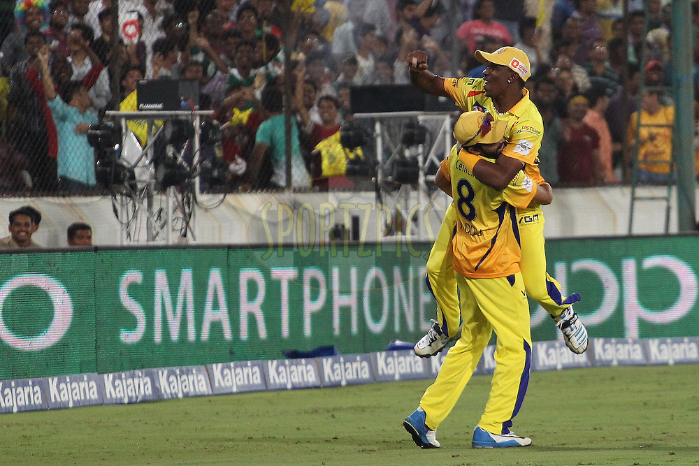 Dwayne BRAVO of the Chennai Superkings celebrates the wicket of Thisara PERERA of the Kings XI Punjab  with Ravindra JADEJA of the Chennai Superkings  during the second semi final match of the Oppo Champions League Twenty20 between the Kings XI Punjab and the Chennai Superkings held at the Rajiv Gandhi Cricket Stadium, Hyderabad, India on the 2nd October 2014<br /> <br /> Photo by:  Ron Gaunt / Sportzpics/ CLT20<br /> <br /> <br /> Image use is subject to the terms and conditions as laid out by the BCCI/ CLT20.  The terms and conditions can be downloaded here:<br /> <br /> http://sportzpics.photoshelter.com/gallery/CLT20-Image-Terms-and-Conditions-2014/G0000IfNJn535VPU/C0000QhhKadWcjYs