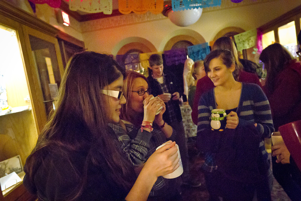 "Sofia Carpio Leon '12 and other students sip hot chocolate and mingle during the Day of the Dead gathering in Goodnow Hall, sponsored by Professor John Seebach and the Anthropology Department. The Day of the Dead (""dia de los muertos"") is a Mexican holiday to honor loved ones who have passed away."