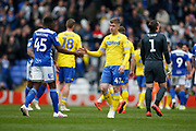Leeds United forward Jack Clarke (47) and Birmingham City defender Wes Harding shake hands at full time during the EFL Sky Bet Championship match between Birmingham City and Leeds United at St Andrews, Birmingham, England on 6 April 2019.