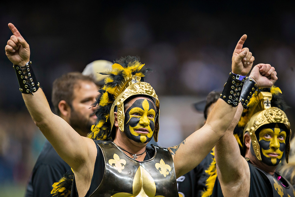 NEW ORLEANS, LA - NOVEMBER 24:  Fans of the New Orleans Saints on the field before a game against the Baltimore Ravens at Mercedes-Benz Superdome on November 24, 2014 in New Orleans, Louisiana.  The Ravens defeated the Saints 34-27.  (Photo by Wesley Hitt/Getty Images) *** Local Caption ***