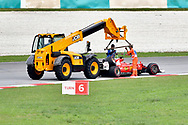Sebastian Vettel of Scuderia Ferrari's car is recovered after crashing during the Malaysian Formula One Grand Prix at the Sepang International Circuit, Malaysia.<br /> Picture by EXPA Pictures/Focus Images Ltd 07814482222<br /> 01/10/2017<br /> *** UK &amp; IRELAND ONLY ***<br /> <br /> EXPA-EIB-171001-0245.jpg