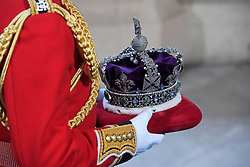 Queen Elizabeth II's crown arriving for the State Opening of Parliament by Queen Elizabeth II, in the House of Lords at the Palace of Westminster in London.