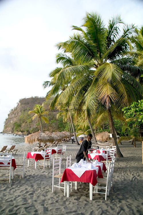 Setting up for dinner on the beach at Anse Chastanet Resort, St. Lucia