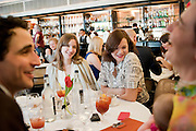 ZAC POSEN; VALENTINE FILLOL CORDIER; JASMINE GUINNESSLOOKING AT JASMINE GUINNESS'S DAUGHTER  RUBY RAINEY BEING HELD BY ERIN O'CONNOR, The launch of the Belvedere Bloody Mary Brunch to London's Caprice. Le Caprice. Arlington st. London. 7 April 2011.  -DO NOT ARCHIVE-© Copyright Photograph by Dafydd Jones. 248 Clapham Rd. London SW9 0PZ. Tel 0207 820 0771. www.dafjones.com.