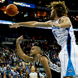 October 31, 2012; New Orleans, LA, USA; San Antonio Spurs point guard Tony Parker (9) shoots over New Orleans Hornets center Robin Lopez (15) during the second half of a game at the New Orleans Arena. The Spurs defeated the Hornets 99-95. Mandatory Credit: Derick E. Hingle-USA TODAY SPORTS