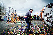 A child from the Roma settlement joins the parade crowd with his bike