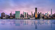 "The glassy still waters of the East River at dawn duplicated this spectacular New York City skyline scene.  The saturated film that I used reacted to the long exposure and low yet colorful light with hues of indgo and blue.  This sprawling image is meant to be printed very large and is recommended in size 72""x40,"" although 60""x34"" and 48""x27"" would also work very well.  Additional sizes may be available upon request."