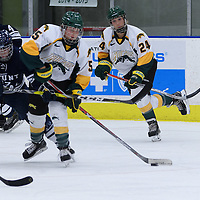2nd year forward Jaycee Magwood (5) of the Regina Cougars handles the puck as teammate Merissa Zerr (24) watches with a keen eye during the Women's Hockey Homeopener on October 7 at Co-operators arena. Credit: Arthur Ward/Arthur Images