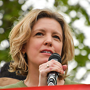 Speaker Laura Parker of Momentum at Climate Emergency Now demonstration at Parliament Square on 1 st May 2019, London, UK.