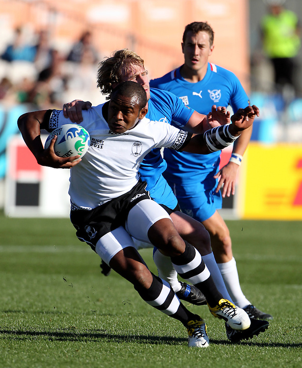 Fiji's Kini Muurimurivalu is tackled by Namibia's defence in their Rugby World Cup pool match at Rotorua International Stadium, Rotorua, New Zealand, Saturday, September 10, 2011. Credit:SNPA / John Cowpland