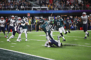 Philadelphia Eagles tight end Zach Ertz (86) is covered by New England Patriots free safety Devin McCourty (32) as he takes two steps while catching an 11 yard touchdown pass good for a 38-33 late fourth quarter Eagles lead during the 2018 NFL Super Bowl LII football game against the New England Patriots on Sunday, Feb. 4, 2018 in Minneapolis. The Eagles won the game 41-33. (©Paul Anthony Spinelli)