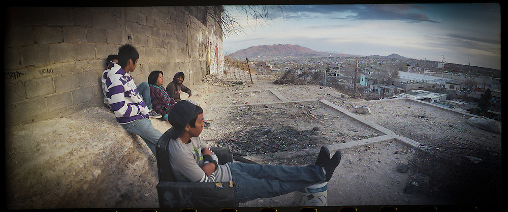 A group of teenagers hang out in the Diaz Ordaz colonia in an area that overlooks the city of Ciudad Juarez, Mexico in 2011. The group hangs out there so they can see if dangerous people are approaching.