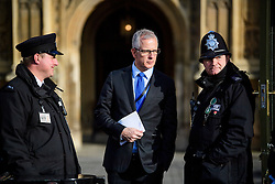 © Licensed to London News Pictures.07/03/2017.London, UK. Lib Dem peer, LORD PADDICK talks to police officers at the Lords entrance to Parliament ahead of a vote in the Lord's on the third reading of the Brexit bill. .Photo credit: Ben Cawthra/LNP