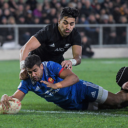 France's Wesley Fofana beats NZ's Rieko Ioane to score during the Steinlager Series international rugby match between the New Zealand All Blacks and France at Forsyth Barr Stadium in Wellington, New Zealand on Saturday, 23 June 2018. Photo: Dave Lintott / lintottphoto.co.nz