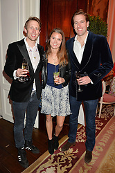 Left to right, GEORGE FROST, EMMA BORGERHOFF and WILFRED FROST at the Tatler Best of British party in association with Jaegar held at The Ritz, Piccadilly, London on 28th April 2015.