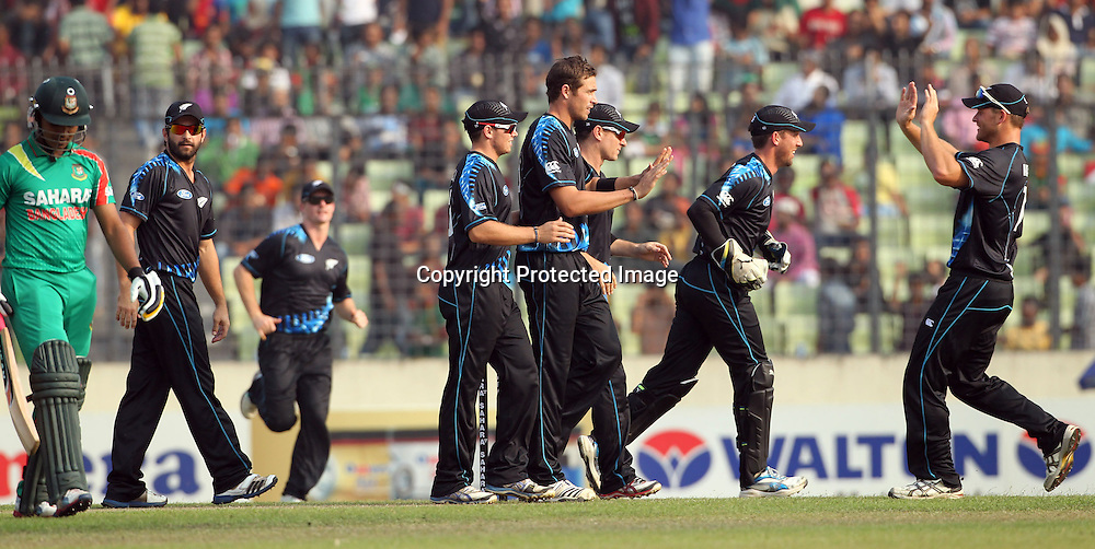 Players celebrate a wicket of Shamsur Rahman, New Zealand Black Caps v Bangladesh, 1st and only T20 international cricket match at Shere Bangla National Stadium, Mirpur, Bangladesh. 6 November 2013. Photo: Shamsul Hoque Tanku/Photosport.co.nz