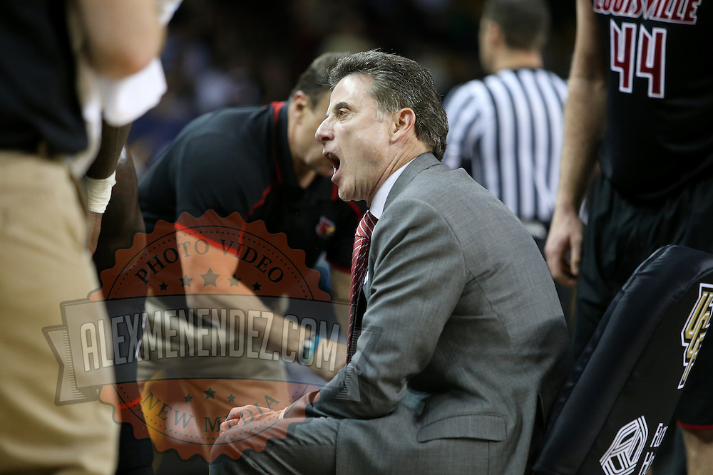 Louisville head coach Rick Pitino is seen during an NCAA basketball game between the 14th ranked Louisville Cardinals and the UCF Knights at the CFE Arena on Tuesday, December 31, 2013 in Orlando, Florida. (AP Photo/Alex Menendez)