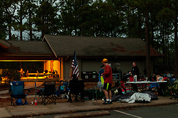 January 19, 2019 - Southern Pines, North Carolina, US - Jan. 19, 2019 - Southern Pines N.C., USA - The lights come on as race support teams get ready for the evening during the 10th Annual Weymouth Woods 100km ultra marathon at the Weymouth Woods Nature Preserve. Runners needed to complete 14 laps of the 4.47 mile course for 62.58 miles in under the 20-hour time allotment. (Credit Image: © Timothy L. Hale/ZUMA Wire)