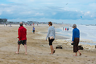 Spring Lake, NJ US -- Sept 3, 2016.  People on a beach as a storm approaches. Editorial Use Only.