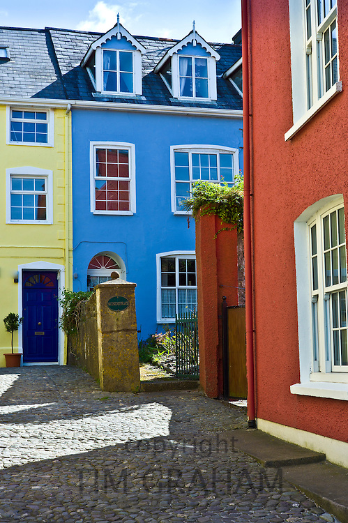 Brightly coloured houses in cobbled alleyway in Kinsale, County Cork, Ireland