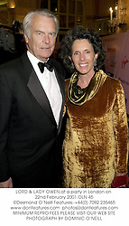 LORD & LADY OWEN at a party in London on 22nd February 2001.OLN 45