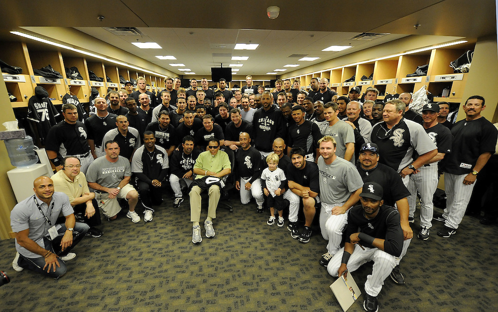 GLENDALE, AZ - MARCH 08:  Players, coaches and staff of Chicago White Sox gather around boxing legend Muhammad Ali for a group photo prior to the game against the Colorado Rockies on March 08, 2011 at The Ballpark at Camelback Ranch in Glendale, Arizona. The White Sox defeated the Rockies 9-8.  (Photo by Ron Vesely)