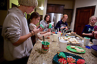 The Avalanche basketball team decorates Christmas cookies for the coaches Friday, Dec. 21, 2013 in Coeur d'Alene, Idaho