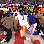 San Francisco 49ers quarterback Colin Kaepernick prays with other players after the New York Giants V San Francisco 49ers, NFL American Football match at MetLife Stadium, East Rutherford, NJ, USA. 16th November 2014. Photo Tim Clayton