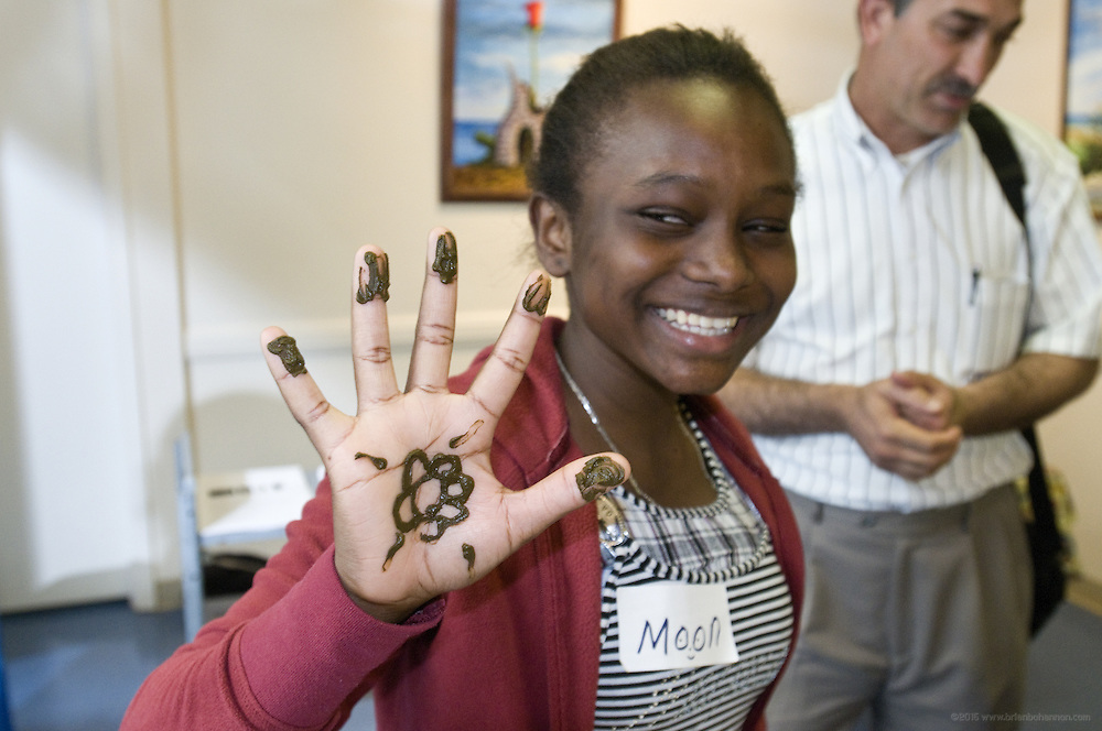 Moon Ibrahim, 14, shows her henna tattoo during the English Conversation Club: Dance and Dialogue event Saturday April 9, 2011 at the Iroquois Branch of the Louisville Free Public Library in Louisville, Ky. Henna and Bindi followed the Bollywood dance lesson, and then volunteers were paired with English language learners to work on conversation skills. (Photo by Brian Bohannon).