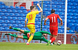 CARDIFF, WALES - Friday, June 5, 2015: Wales' goalkeeper Owain Fon Williams saves from Gareth Bale during a practice match at the Cardiff City Stadium ahead of the UEFA Euro 2016 Qualifying Round Group B match against Belgium. (Pic by David Rawcliffe/Propaganda)
