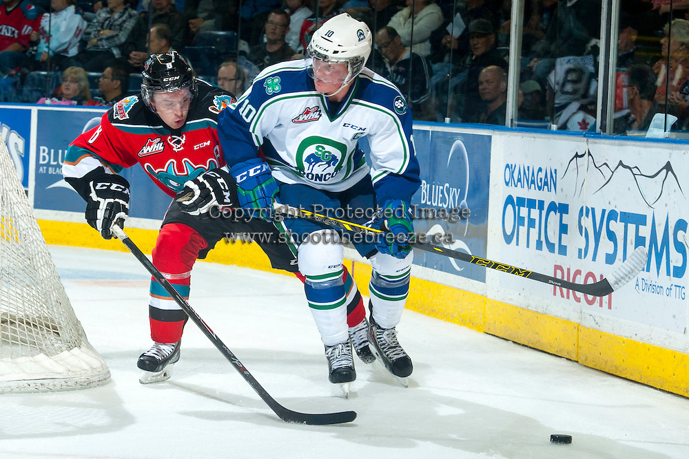 KELOWNA, CANADA - OCTOBER 7: Colby Cave #10 of Swift Current Broncos skates behind the net with the puck as Colten Martin #8 of Kelowna Rockets back checks during second period on October 7, 2014 at Prospera Place in Kelowna, British Columbia, Canada.  (Photo by Marissa Baecker/Getty Images)  *** Local Caption *** Colten Martin; Colby Cave;