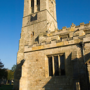 Church of St. Mary the Virgin in Sprotbrough, Doncaster, England. The ancient working sun dial mounted in the church tower can be clearly seen.