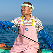 Hasegawa-san working the lines while bringing up crab traps from a depth of 1000 meters in Suruga Bay, Japan