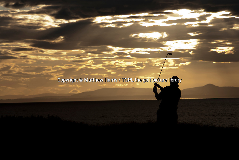 Silhouette of golfer during summer during an evening round at The Glen,North Berwick,East Lothian,Scotland.