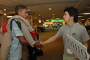 International students at Airpot Photos by Megan Nadolski..airport1.Ohio University peer advisor Simon Byung Ho Lee (right) greets new international student Hariwardhan Jennepally (left) upon his arrival at the airport in Columbus, OH.