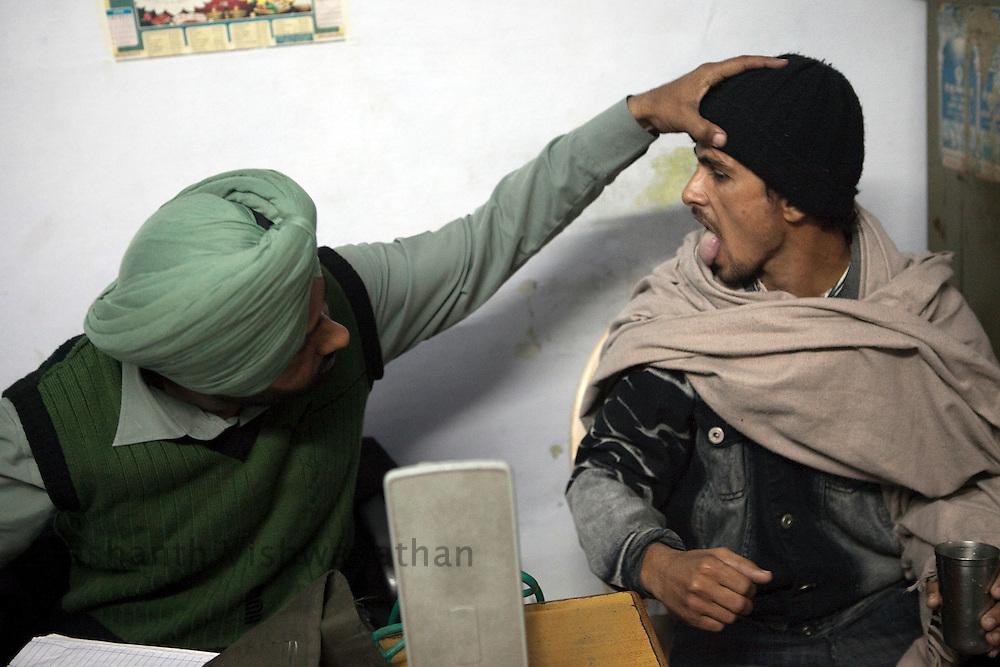 "A doctor checks the general health condition of the drug addicts at ""Navjeevan"" drug rehabilitation center in Amritsar, India, on Wednesday, December 15, 2010. Photographer: Prashanth Vishwanathan/HELSINGIN SANOMAT"