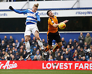 Queens Park Rangers forward Sebastian Polter reaches the ball with his head before Wolverhampton Wanderers defender Danny Batth during the Sky Bet Championship match between Queens Park Rangers and Wolverhampton Wanderers at the Loftus Road Stadium, London, England on 23 January 2016. Photo by Andy Walter.