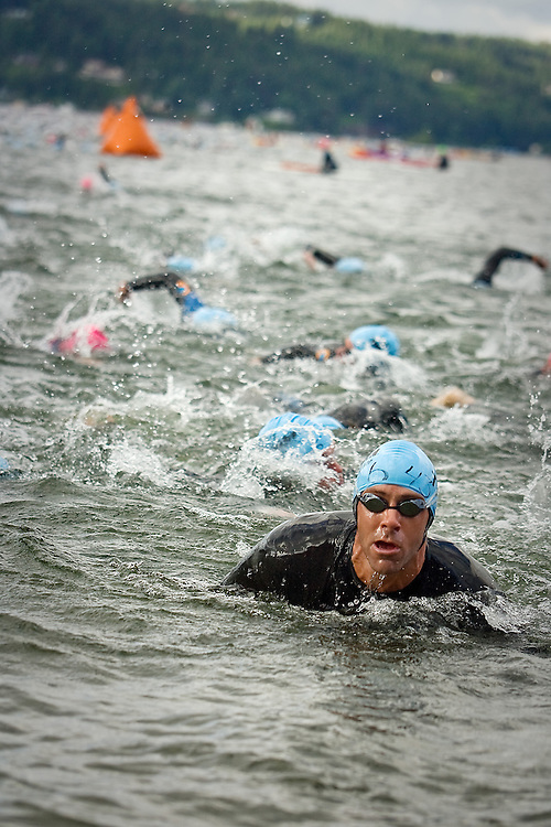 JEROME A. POLLOS/Press..Glenn Mengering, from Longmont, Colo., exits Lake Coeur d'Alene after finishing the 2.4-mile swim Sunday during the Ford Ironman Coeur d'Alene.