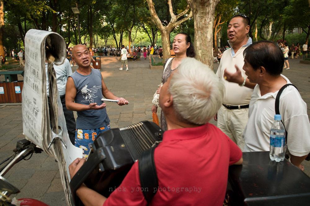 Singing in Lu Xun Park, Shanghai, China.