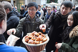 The new iPad Air on sale in London. <br /> Apple employees giving out breakfast to people who have been waiting all night for the new iPad Air at Covent Garden's Apple store, London, United Kingdom. Friday, 1st November 2013. Picture by Daniel Leal-Olivas / i-Images